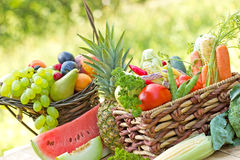 Organic fruit and vegetable in wicker basket Stock Photos