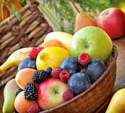 Organic fruit in wicker basket Royalty Free Stock Image