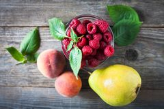 Organic fruit on a wooden background royalty free stock photo
