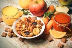 Organic fruits and freshly squeezed fruit juice Royalty Free Stock Image