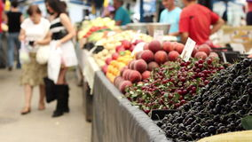 Organic Fruits Market. Cherries, peaches, natural fruits and vegetables at the marketplece stock video footage