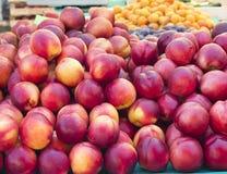 Organic fruits on sunny market Stock Images