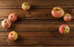 Organic fruits. Tasty imperfect apples on old wooden background. Copyspace stock image