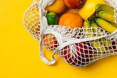 Organic fruits variety in cotton mesh reusable shopping bag - recycling, sustainable lifestyle, zero waste, no plastic. Organic fruits variety in cotton mesh royalty free stock image