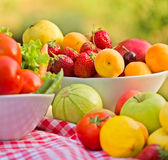 Organic fruits and vegetables in bowls - closeup Stock Images