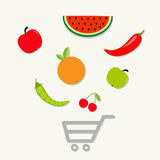 Organic fruits and vegetables on the shopping cart basket. Royalty Free Stock Photo