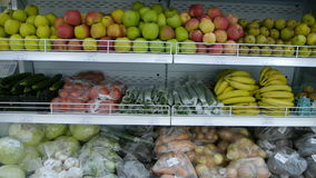 Organic fruits and vegetables on the supermarket shelf. a healthy way of life. vegetarian food.  stock video