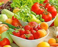 Organic fruits and vegetables. Fruits and vegetables on a table stock images
