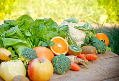 Organic fruits and vegetables on table Royalty Free Stock Image