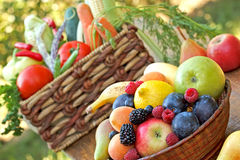 Organic fruits and vegetables on table Stock Image