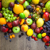 Organic Fruits  with water drops on dark wooden table Royalty Free Stock Photography