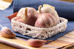 Organic garlic in a basket Stock Photo