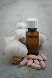 Organic garlic, boottle and herbal pills Royalty Free Stock Photo