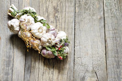 Organic garlic in the kitchen on the wooden table Royalty Free Stock Photos