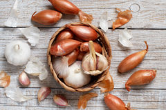 Organic garlic and onion on wooden table Royalty Free Stock Images