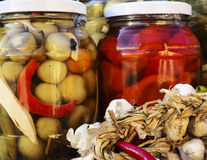 Organic garlic,peppers,pickle jars Royalty Free Stock Image