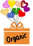 ORGANIC on gift box with multicoloured hearts Stock Photography