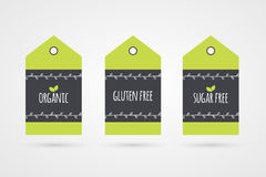 Organic Gluten Sugar Free label set. Vector food icons.. Organic Gluten Sugar Free label set. Vector food icons. Green shopping tag signs with twigs isolated Royalty Free Stock Photos