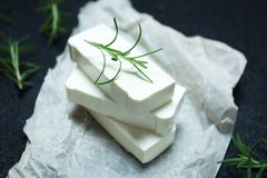 Organic goat cheese feta with rosemary on parchment paper royalty free stock image