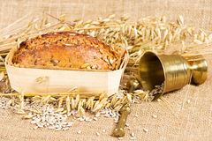 Organic grain bread on burlap Royalty Free Stock Photography