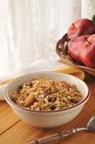 Organic granola. A bowl of organic granola with almonds, walnuts and raisins Stock Photos