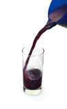 Organic Grape juice. Grape juice puring into a glass cup Stock Images