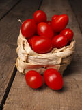 Organic Grape Tomatoes In A Basket Royalty Free Stock Image