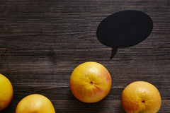 Organic grapefruit in the centre with speech bubble Royalty Free Stock Photos