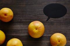 Organic grapefruit in the centre with speechbubble.jpg Stock Photos