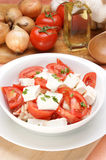 Organic Greek salad in a white bowl Royalty Free Stock Image