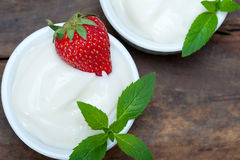 Organic Greek yogurt and strawberry Royalty Free Stock Photos