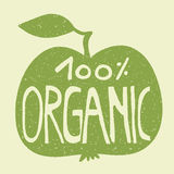 100% organic on a green apple. Hand lettering of the text `100% organic` on a green apple. Stamp effect Stock Photography