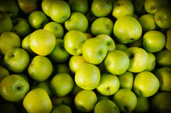 Organic green apples. Zealand is a country of stunning and diverse natural beauty: jagged mountains, rolling pasture land, steep fiords, pristine trout-filled Royalty Free Stock Image
