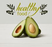 Organic green avocado, clean eating concept, healthy food inscription royalty free stock photos