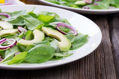 Organic Green Avocado and Spinach Salad with Red Onion Royalty Free Stock Photography