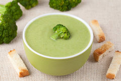 Organic green broccoli soup vegan recipe with. Croutons in green bowl Royalty Free Stock Images