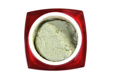 Organic green cosmetic cream in red container isolated on white. Organic green cosmetic cream in red container. make-up cream isolated on white background Royalty Free Stock Photo