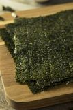 Organic Green Dry Roasted Seaweed Sheets. On a Board Royalty Free Stock Photos