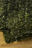 Organic Green Dry Roasted Seaweed Sheets. On a Board Royalty Free Stock Image