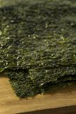 Organic Green Dry Roasted Seaweed Sheets. On a Board Stock Images
