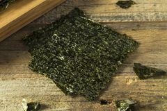 Organic Green Dry Roasted Seaweed Sheets. On a Board Stock Photography