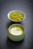 Organic Green Matcha Tea. In a small cup on slate background Stock Image