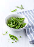 Organic Green Pea Pods in a Bowl Stock Images