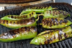 Green peppers grilling on the barbecue stock photo
