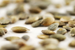 Organic green pumpkin seeds against a white background Stock Image