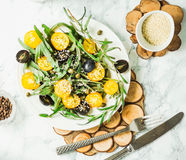 Organic green salad with arugula, yellow tomatoes, olives, sesam. Organic green salad with arugula, yellow tomatoes, olives, grapes and sesame,healthy lifestyle Royalty Free Stock Photo