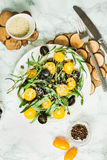 Organic green salad with arugula, yellow tomatoes, olives, sesam. Organic green salad with arugula, yellow tomatoes, olives, grapes and sesame,healthy lifestyle Stock Images