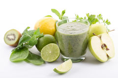 Organic green smoothie with spinach. Kiwi, apple, lemon Royalty Free Stock Images