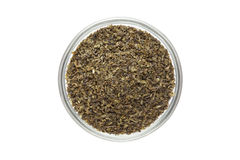 Organic Green tea (Camellia sinensis) Tea bag cut, dried leaves, in glass bowl. Stock Photography