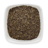 Organic Green tea (Camellia sinensis) Tea bag cut, dried leaves. Stock Photo